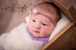 Newborn in newborn bed