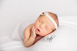 newborn girl in white