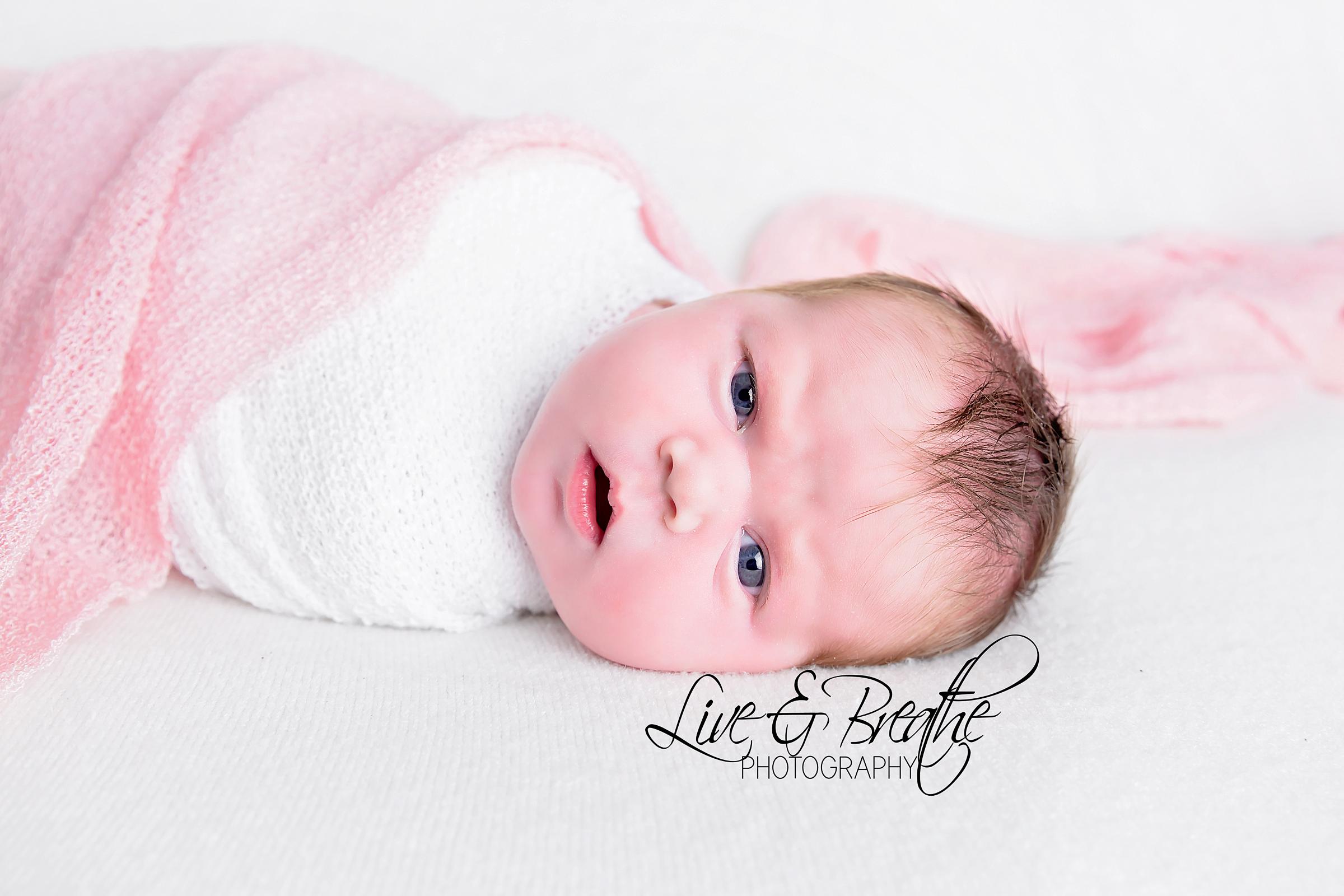 newborn girl in pink