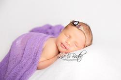 newborn girl in purple