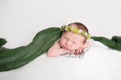 newborn girl in green