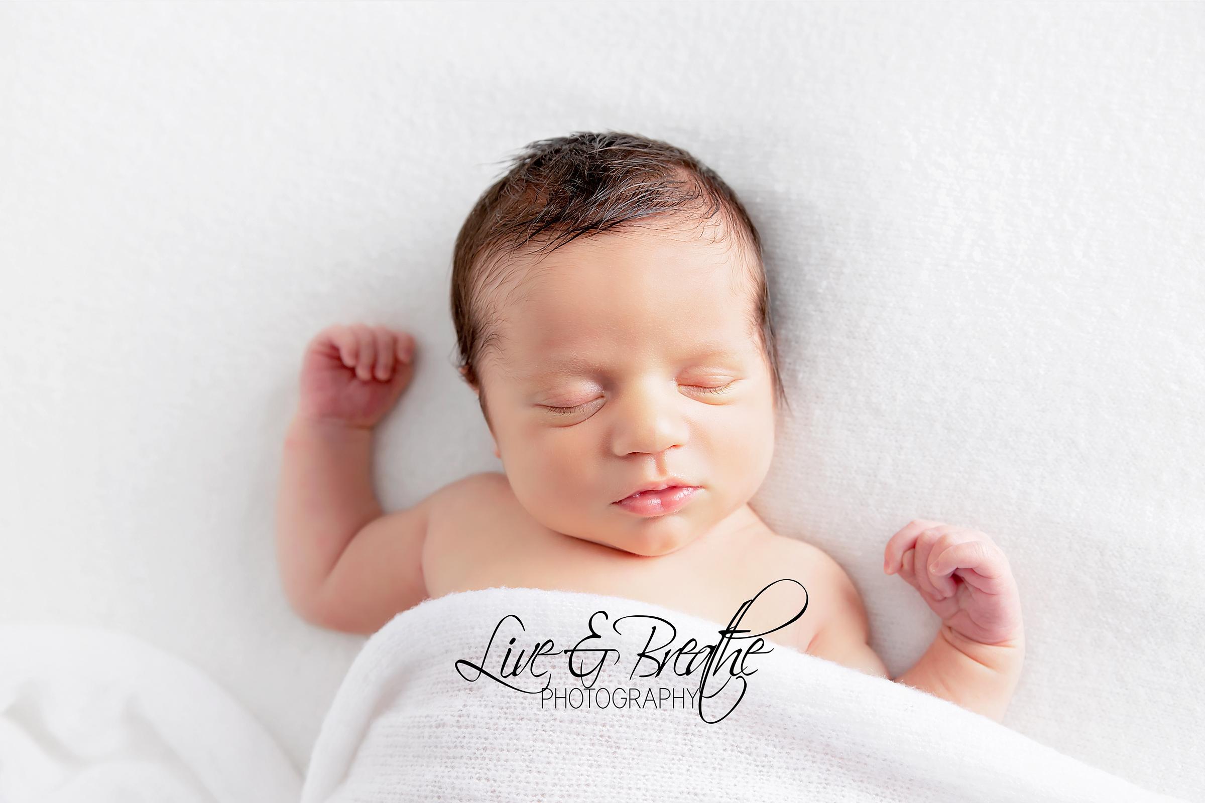 newborn boy sleeping
