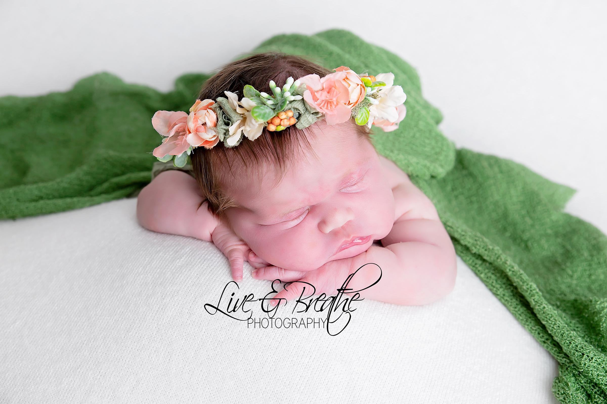 newborn in green halo