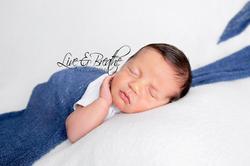 newborn boy in blue