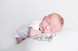 sleepy newborn boy