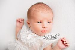 newborn girl in dress