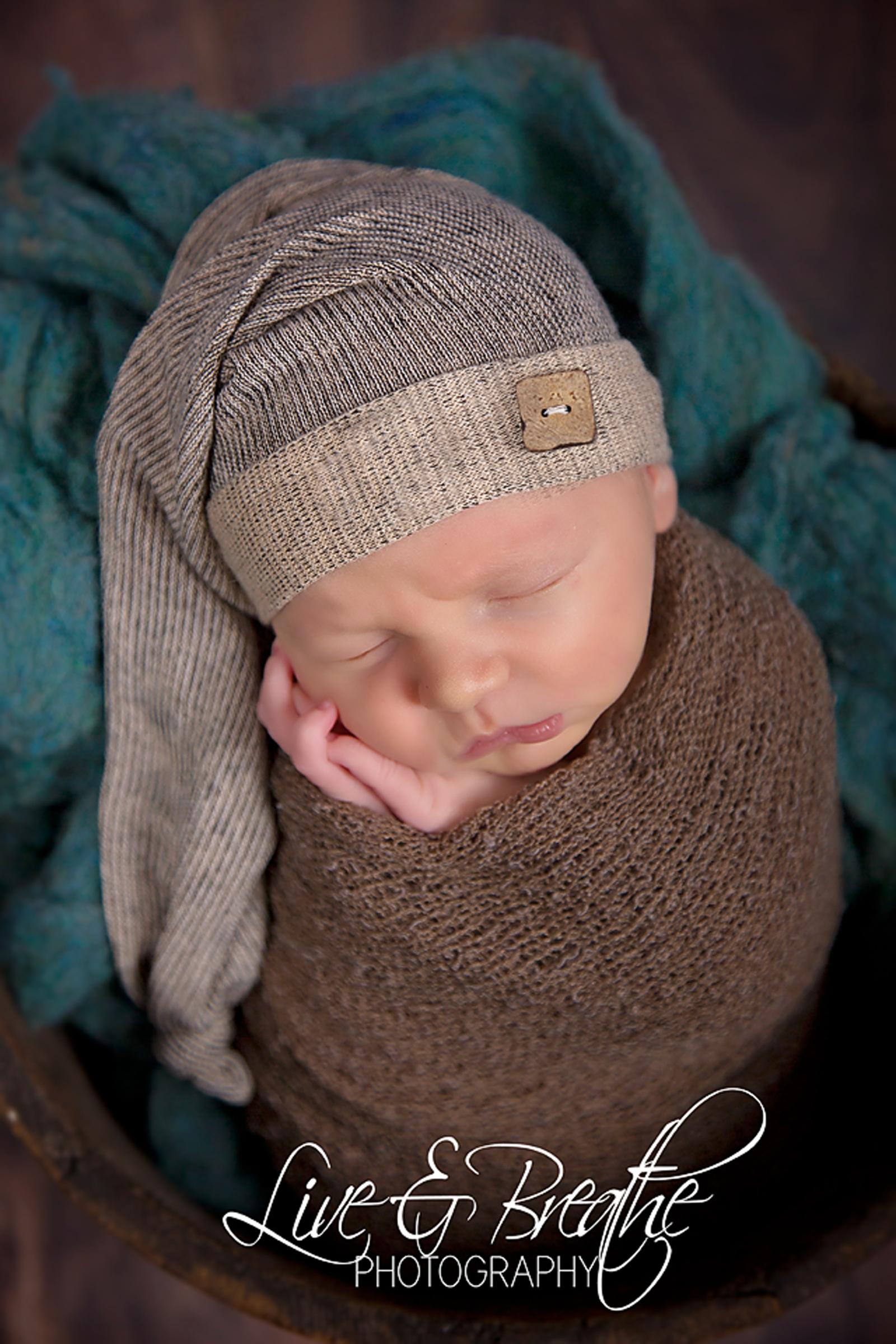 Newborn with sleepy hat