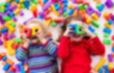 Happy preschool age children play with c