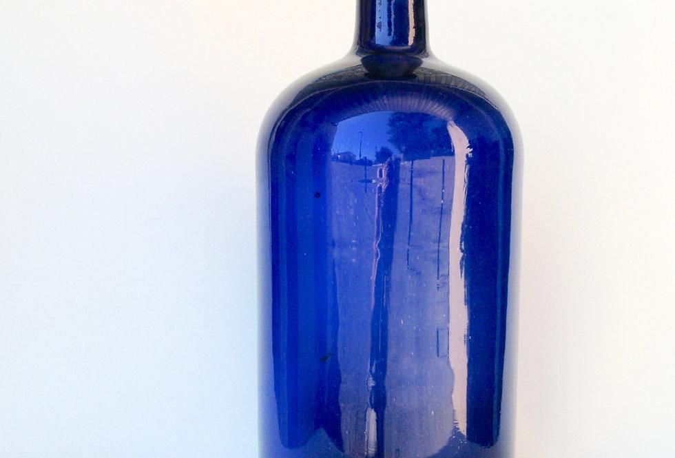 Flacon ancien en verre soufflé