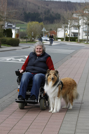 multiple sclerosis patient spending time outdoors with loyal dog