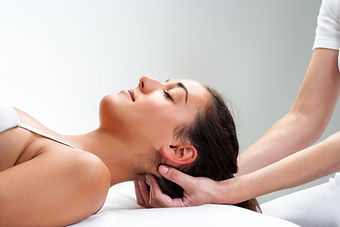 Close up of  chiropractor pressing back of head. Therapist doing healing massage with fing