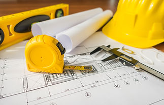 construction-plans-with-yellow-helmet-dr