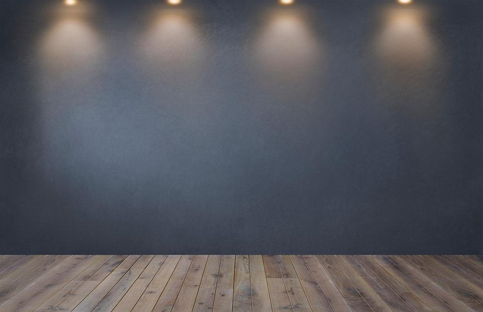 dark-gray-wall-with-row-spotlights-empty