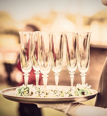 Waiter%20with%20Champagne%20Flutes_edited.jpg