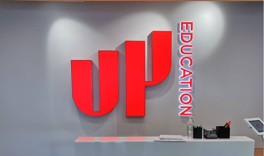 Up Education illuminated sign