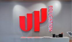 Up Education illuminated sign