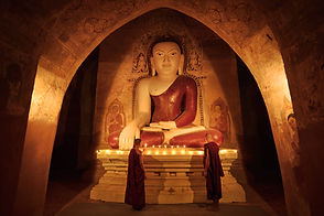 Novice Monks Lighting Candles