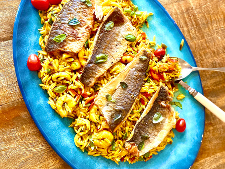 Crispy seabass with saffron orzo, squid and prawns.