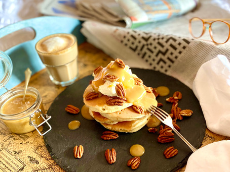 Fluffy American pancakes with pecans and butterscotch sauce.