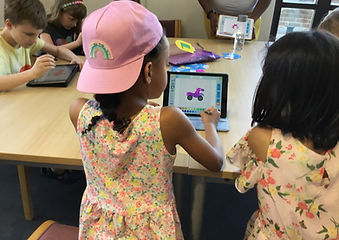 group coding class, children using their First Class Coders tablets in Wallington, London.