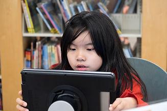 problemsolving kid-using-digital-tablet-