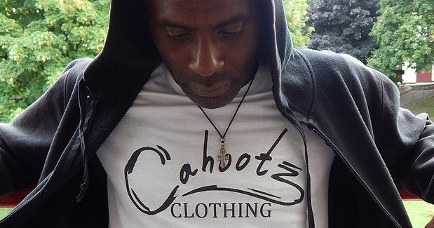 Model wearing a White tshirt with Cahootzclothing Large Logo