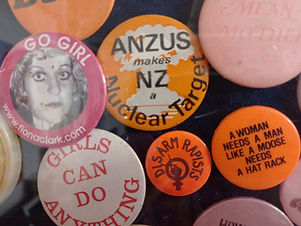 A small selection of orange and pink lesbian badges
