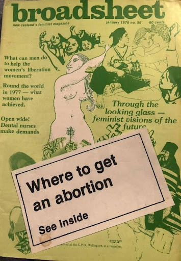 A broadsheet magazine with a large sticker on front - where to get an abortion