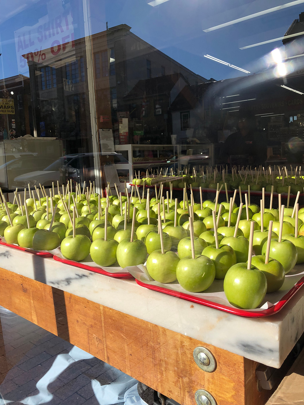 Green apples in window store front