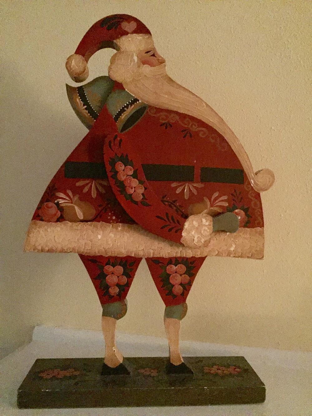 Wooden flowered painted Santa figure