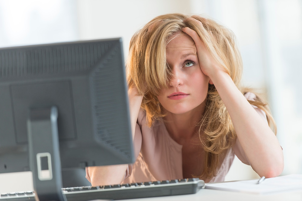 Frustrated woman in front of computer