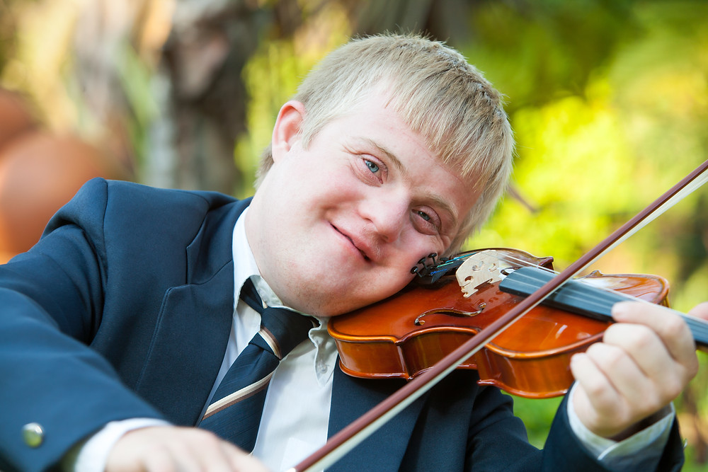 Boy with Down Syndrome playing violin