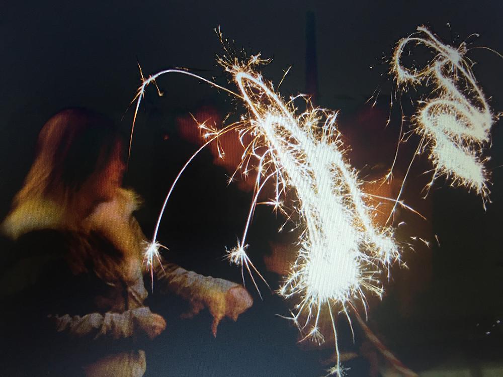 Children waving sparklers