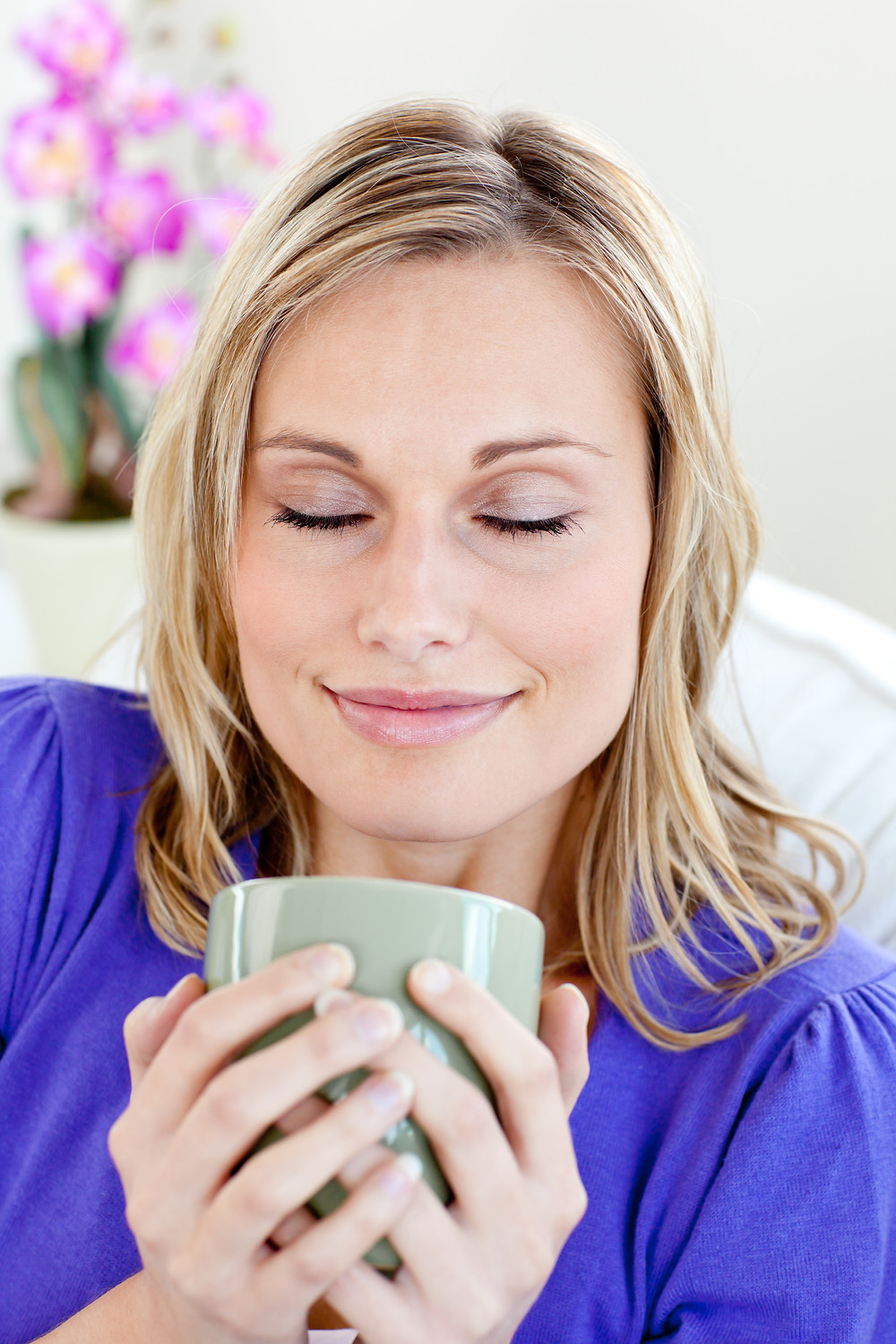 Woman peacefully holding cup of coffee