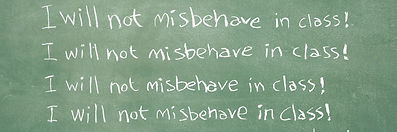 "Photo of a chalkboard with the sentence ""I will not misbehave in class!"" repeatedly written."
