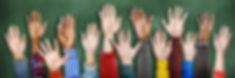 Picture of children's hands raised in the air.