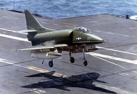 Camouflaged_A-4C_of_VA-113_landing_on_US