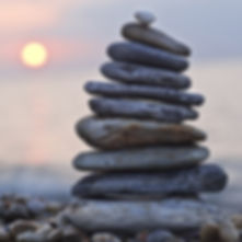 Balancing stones at sunset