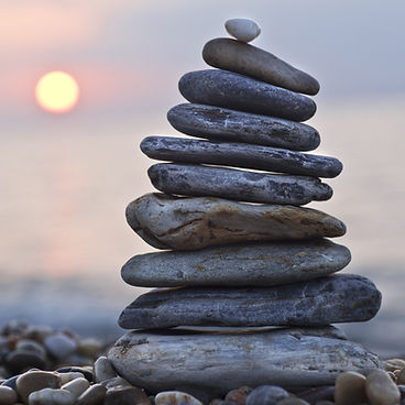 Balancing stones at sunset