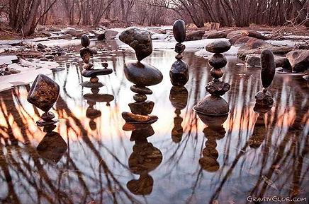 Balancing stones on a pond photo by gravityglue.com