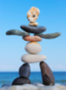 Balancing stones depicting a child