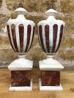 Rouge and White Marble Urns.