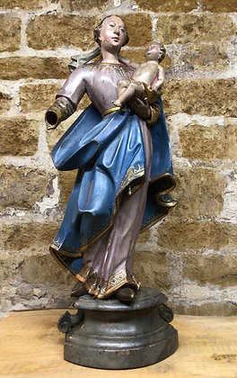 Carved Wood Figure of Charity, in blue holding infant