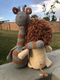 Giraffe & Lion hugging.jpeg