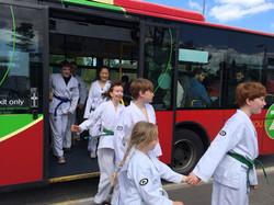 16 Taekwondo Students get on a Bus