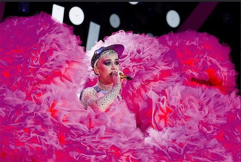 Virna Pasquinelli Millinery. Giant pink pompoms for Katy Perry's dancers for her show at Glastonbury festival. Virna Pasquinelli creates Katy Perry's dancers costumes.