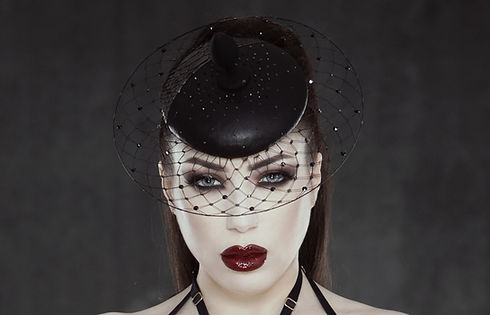 Erotic millinery, alternative fashion designer, queer millinery, queer hats, non-binary fashion, fetish hats, avant-garde hats, avant-garde fashion.