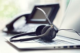 headset-headphones-telephone-and-laptop-