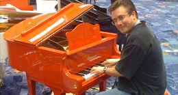 Don Turney at the mini grand piano