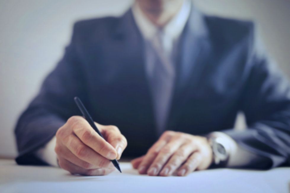 crop-businessman-signing-contract-in-off